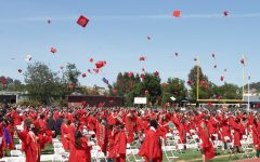 Tossing their caps into the air, the graduates celebrate the end of their high school journeys. Congratulations to the new Redwood Alumni!