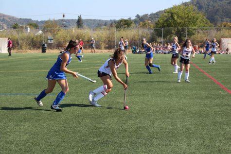 Pushing up the field, Senior Megan Minturn dominates the ball.