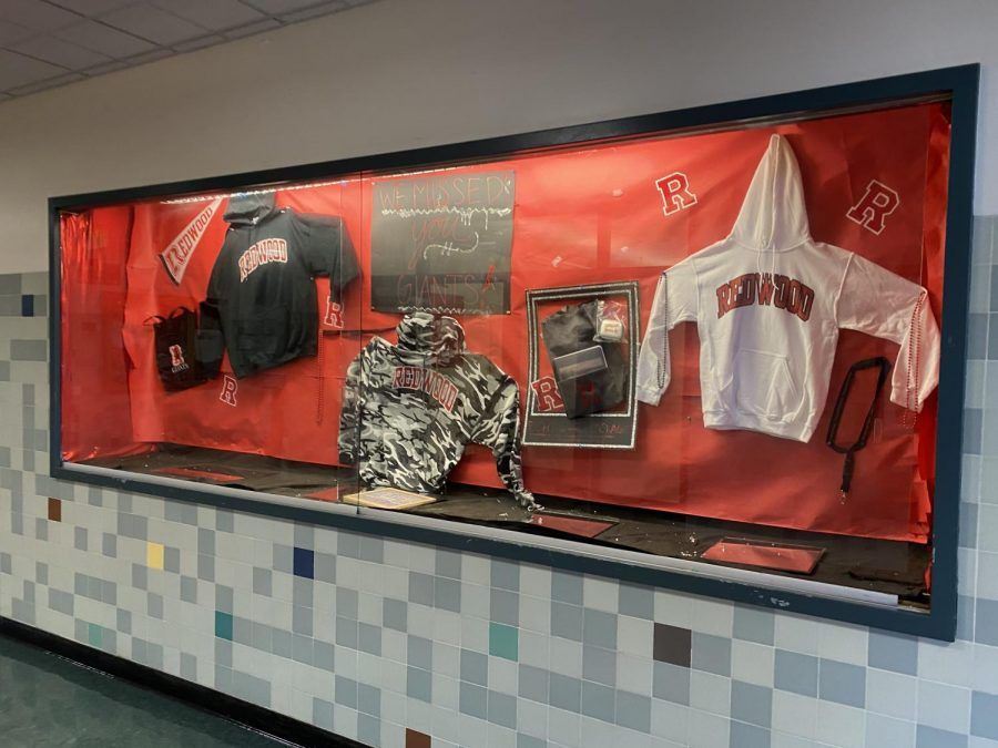 Passing by the front entrance display case, students can find items from the Right Start Package and more school swag for purchase.