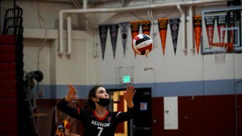 Senior Jordan Vasquez (#7) serves a ball for varsity volleyball during their game against Maria Carillo High School.