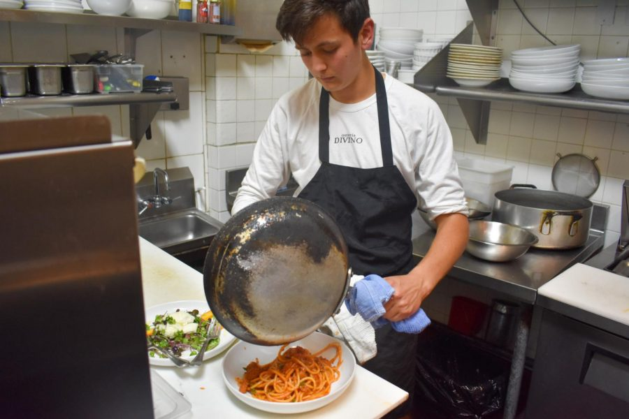 Senior Leo Siminoff preparing dishes for the busy night hours at Osteria Divino.