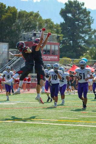 Varsity football team dominates College Park in first game
