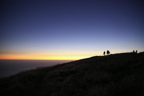 Watching the sun sink below the horizon, Marin residents unwind, relax and enjoy the stunning view of the Pacific Ocean at Bolinas Fairfax Ridge.