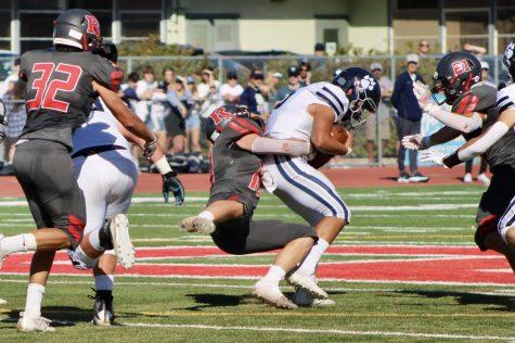 Senior middle linebacker Hudson Brekhus-Lavinsky tackles an MC running back, Drew Ramos.