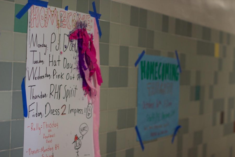 Covering the hallway walls, homecoming posters inform Redwood students about spirit week.