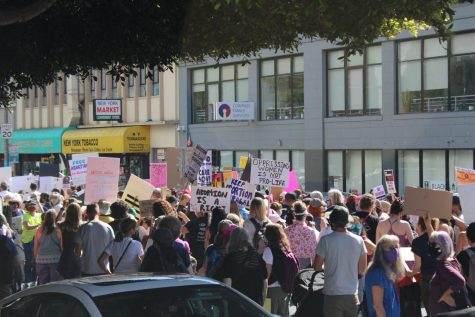 Gathering on the streets of San Francisco, residents of the Bay Area march in support of womens rights.