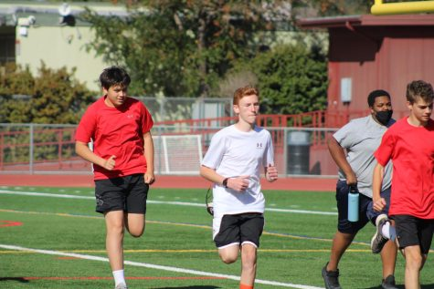 Warming up during PE, freshmen prepare to participate in the traditional Monday run-day.