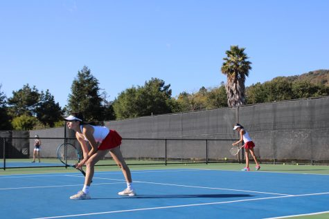 Preparing for the next point, doubles partners Isabella Kraus and Kate Tuhtan get in their stances.